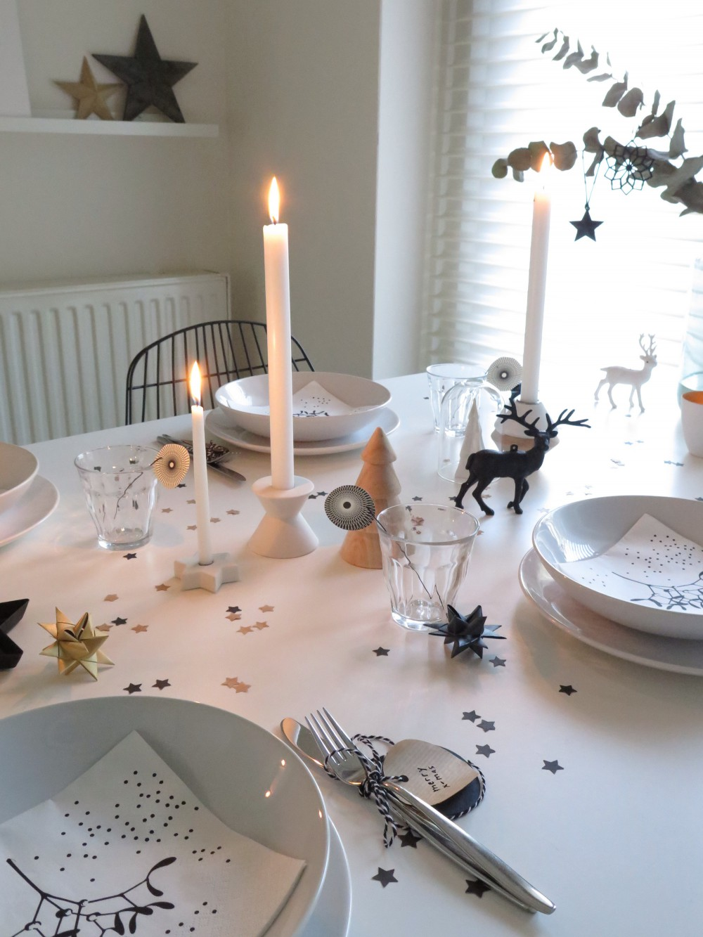 Christmas dinner table with a touch of black, white, gold and wood.